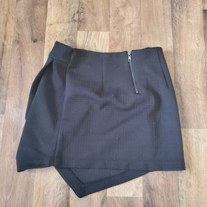 A black skirt with a little fabric detail